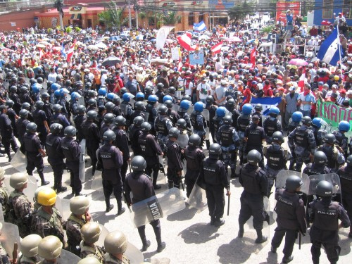 """Protest march against coup in front of """"Isis Obed Murillo"""" international airport in Tegucigalpa. Photo: Sandra Cuffe"""
